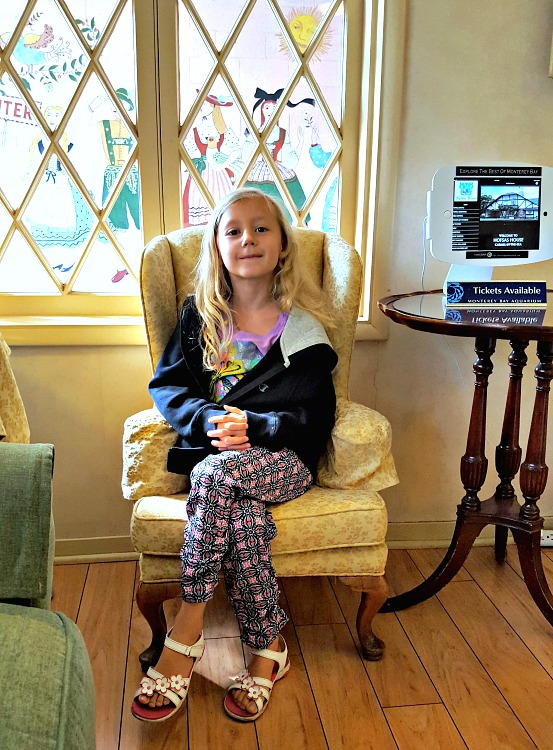 Kaylee sitting in the kids chair in the Hofsas House lobby
