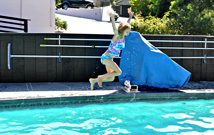 Kaylee jumping into the pool at Hofsas House