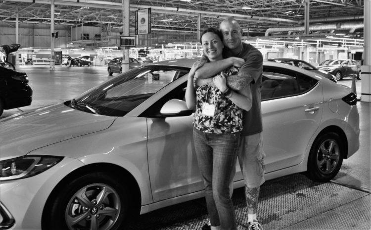 Brian and Chrystal standing by a Hyundai Elantra Eco