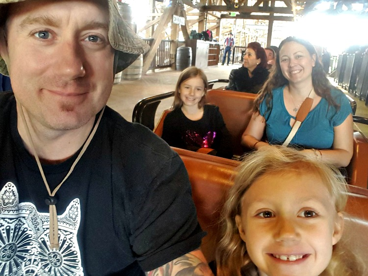 Our family on the Ghostrider Roller Coaster at Knott's Berry Farm