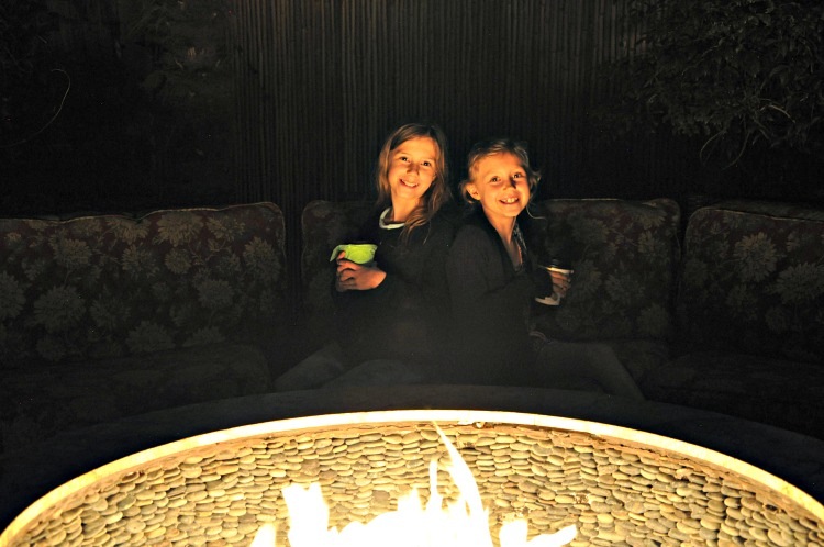 Zoë and Kaylee enjoying hot chocolate by the fire pit at Pantai Inn in La Jolla, CA