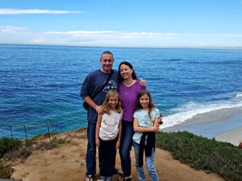 Family photo in front of the ocean in La Jolla, CA