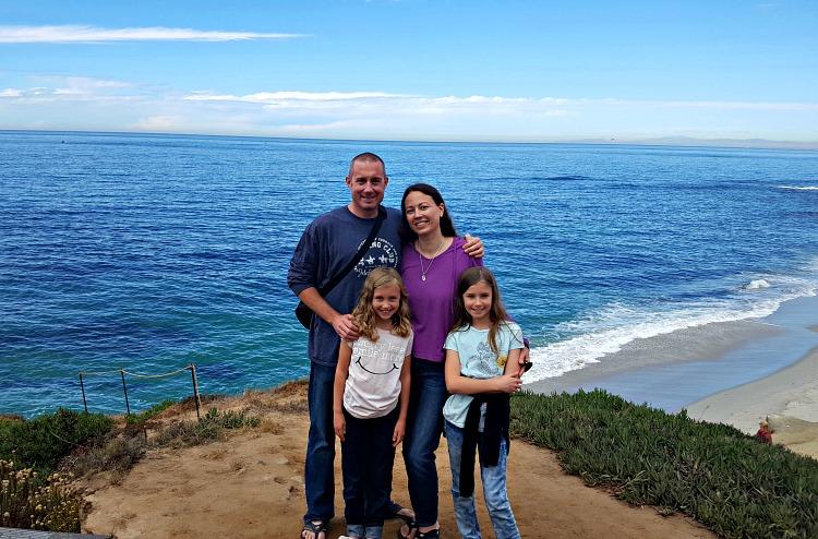 Family photo in front of the ocean in La Jolla, CA