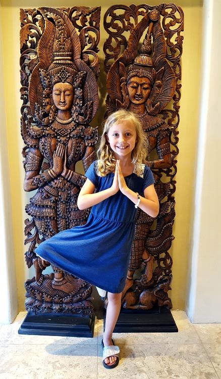 Kaylee practicing tree pose at the Pantai Inn in La Jolla, CA
