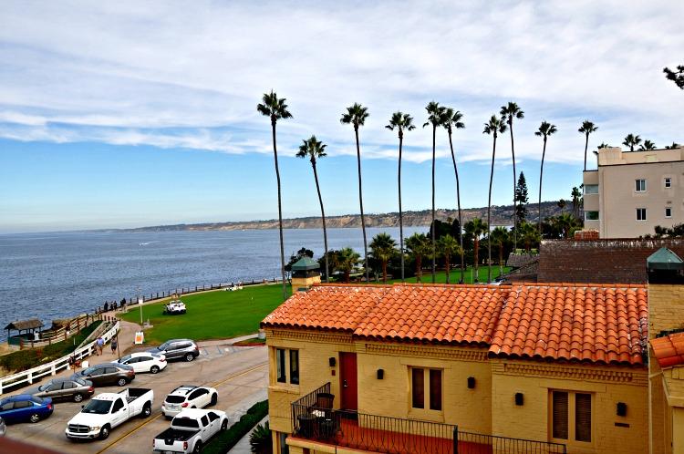 Pantai Inn rooftop of of ocean, beach and palm trees in La Jolla, CA