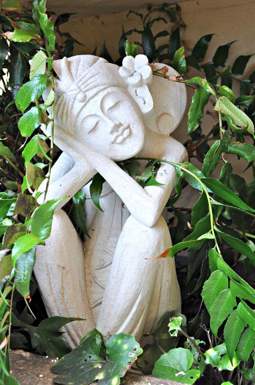Balinese statue in the bushes at the Pantai Inn in La Jolla, CA