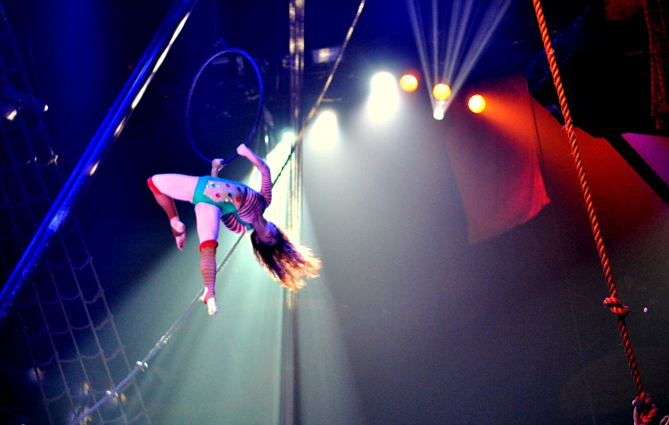 Female acrobat using a ring in the air at the Pirate's Dinner Adventure show