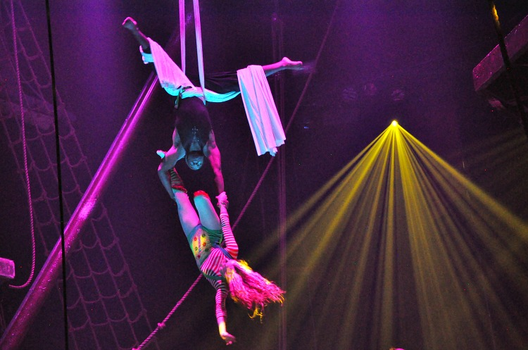 Acrobats flying through the air at the Pirate's Dinner Adventure show