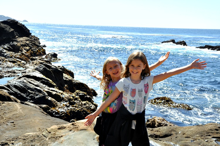 Zoë and Kaylee posing in front of the ocean during our family trip to Point Lobos State Reserve