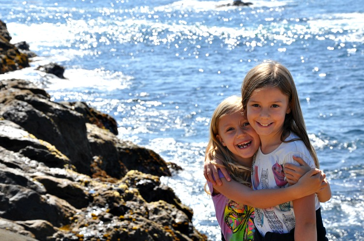 Zoë and Kaylee hugging at Point Lobos State Reserve in Northern California
