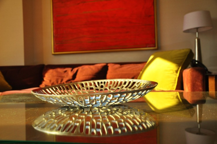 Light reflecting off metal bowl in Red Rock Hotel living room in Las Vegas, NV
