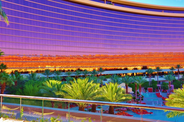 Colorful reflection on Red Rock hotel from pool in the morning