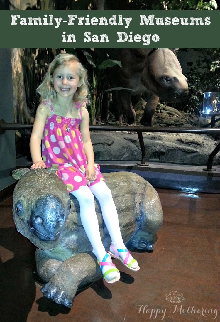 Kalee sitting on a statue at the San Diego Natural History Museum in San Diego, CA