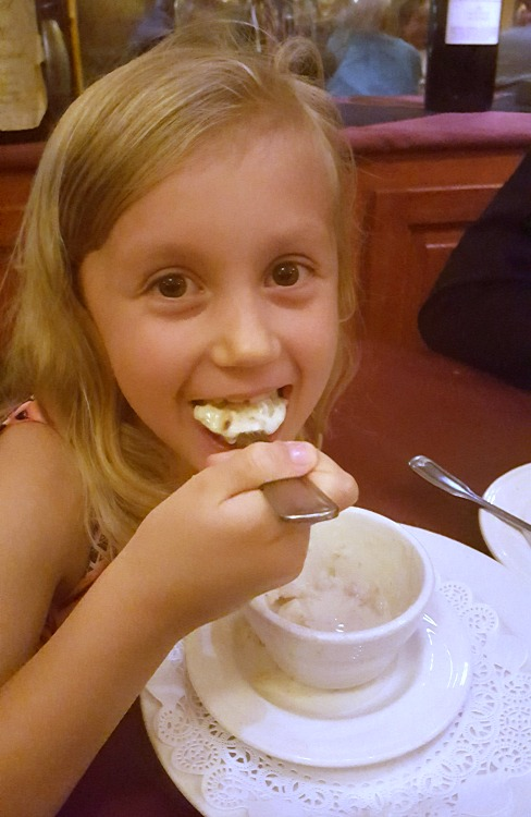 Kaylee eating dessert at The Whaling Station in Monterey, CA