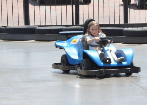 Zoë driving a blue car around the track