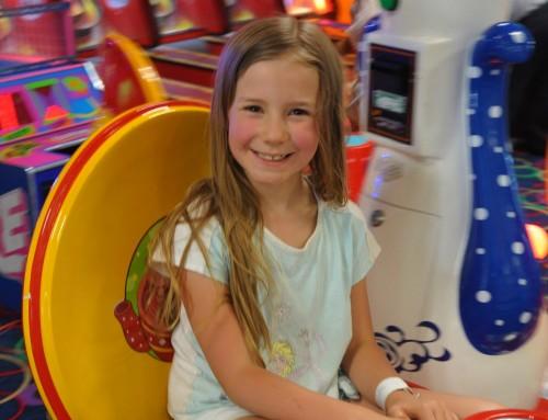 Zoë smiling playing games at Las Vegas Mini Gran Prix