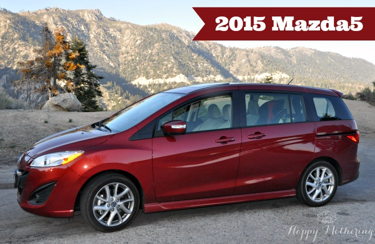 Red 2015 Mazda5 parked on the roads of arctic circle in the mountains