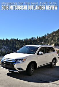 2018 White Mitsubishi Outlander with mountains and blue sky behind it