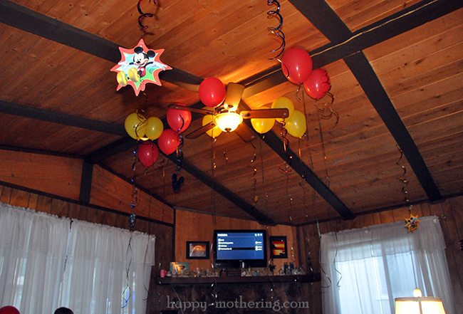 Disney streamers and balloons on the ceiling