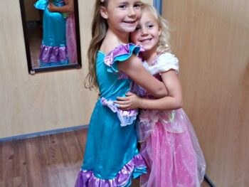 Zoë and Kaylee trying on princess costumes