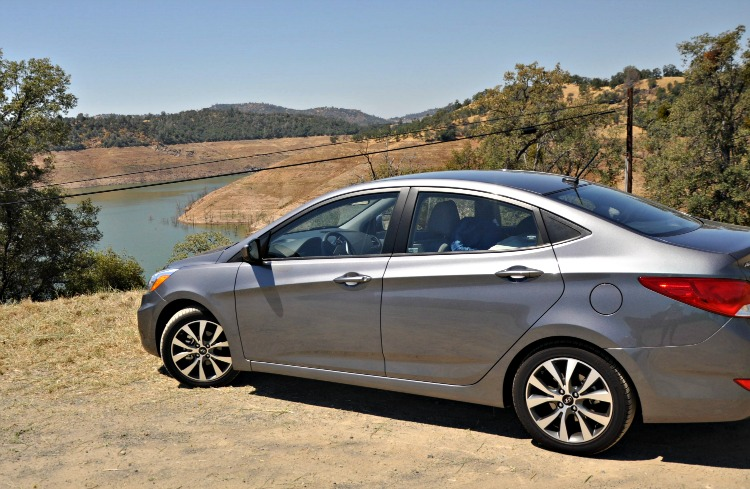 Gray Hyundai Accent GLS in front of water reservoir