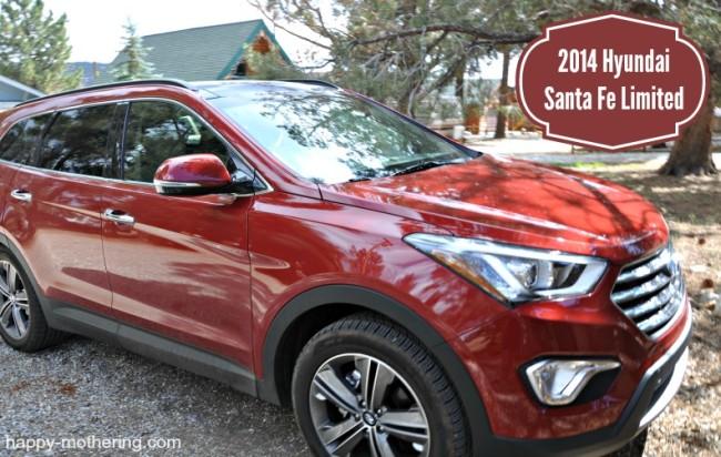 Red Hyundai Santa Fe in a rocky driveway