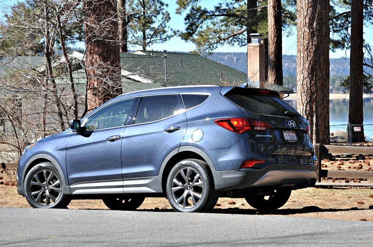 Hyundai Santa Fe Sport in front of Jeffrey Pine trees and Big Bear Lake
