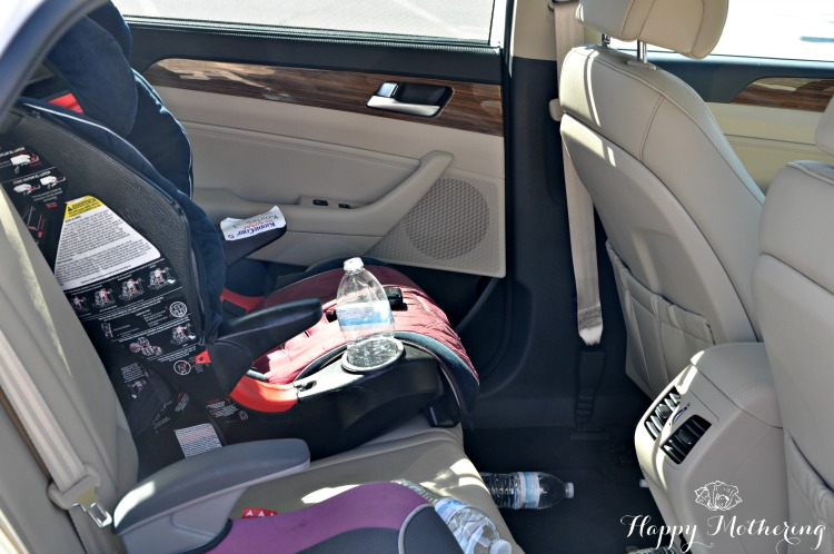 Back seat of the Hyundai Sonata Limited with one car seat and one booster seat