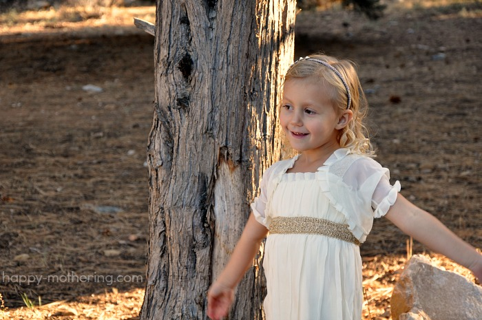 Kaylee modeling her dress in front of a tree