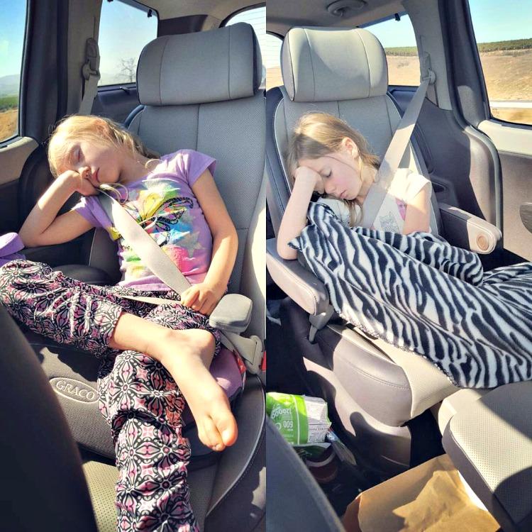Zoë and Kaylee sleeping in the backseat of the Kia Sedona