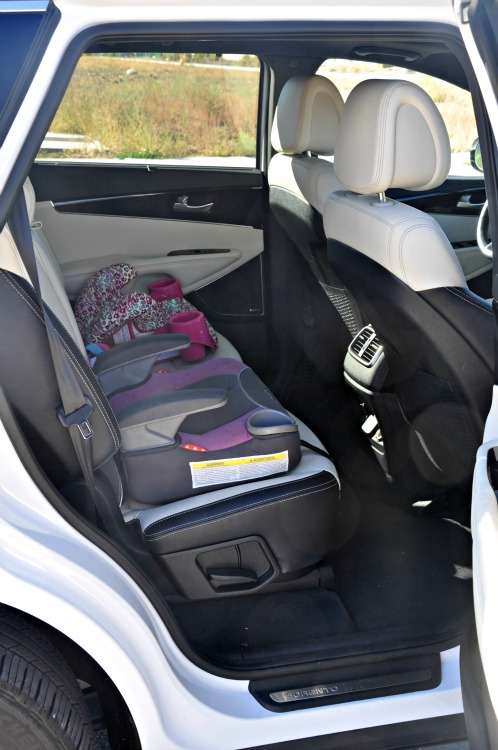 Back seat of the Kia Sorento with two booster seats installed