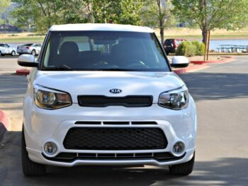 Front view of white Kia Soul in parking lot