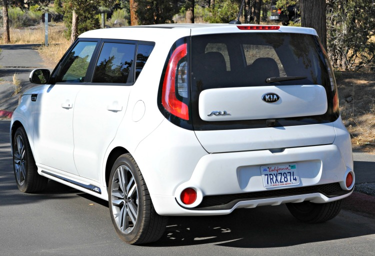 Rear angle view of white Kia Soul