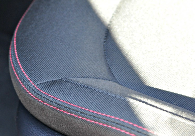 Red stitching on gray cloth seats in Kia Soul