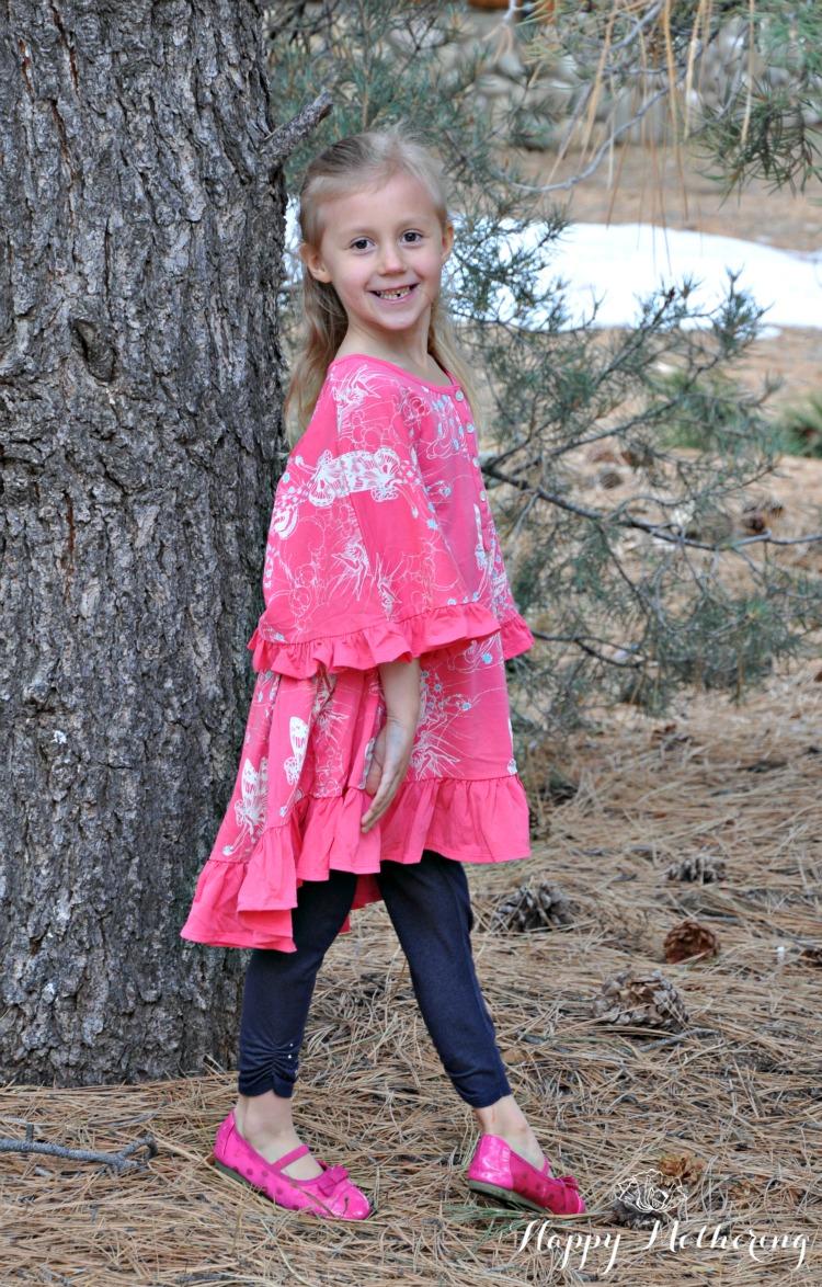 Kaylee modeling for Little Skye Boutique under a big pine tree