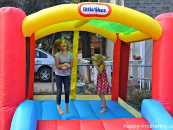 Zoë and Kaylee jumping in their bouncy house for the first time