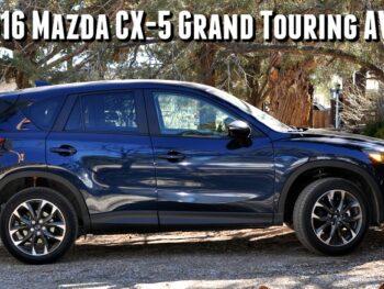 Blue Mazda CX-5 in driveway