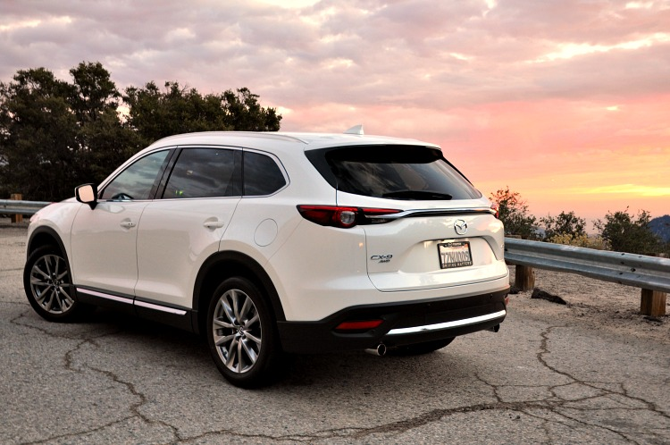 Back angle of Mazda CX-9 with pink clouds in the background