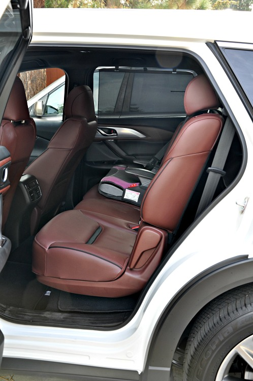 Mazda CX-9 backseat with booster seat in it