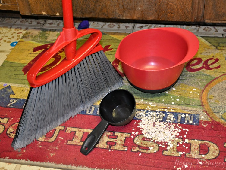 Broom to sweep up mess on floor from baking