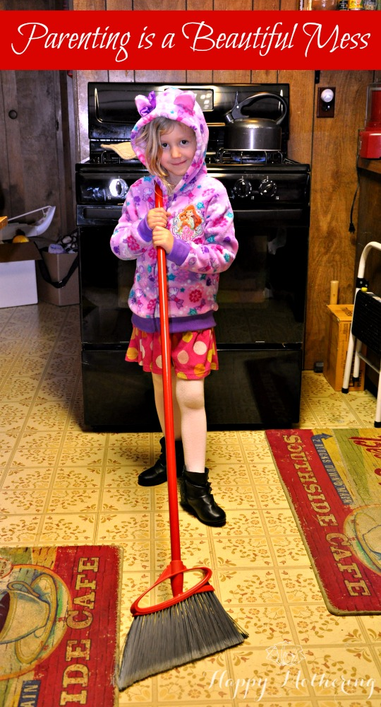 Kaylee sweeping up the kitchen floor