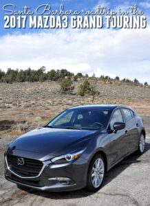 Mazda3 Grand Touring car on the side of a mountain road with cloudy skies in the background