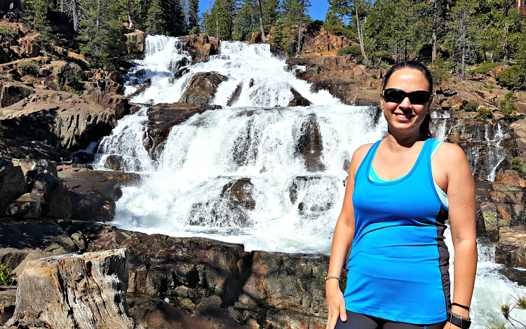 Chrystal standing in front of a waterfall in Tahoe South
