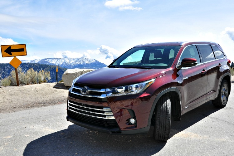 Toyota Highlander Hybrid in a mountain turnout with clouds and mountains behind it