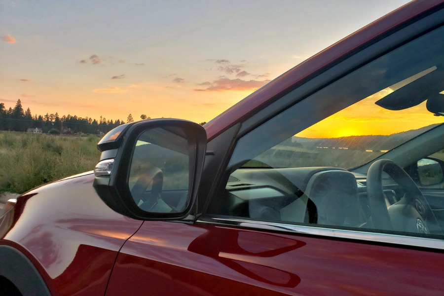Toyota RAV4 mirror with sunset in the background