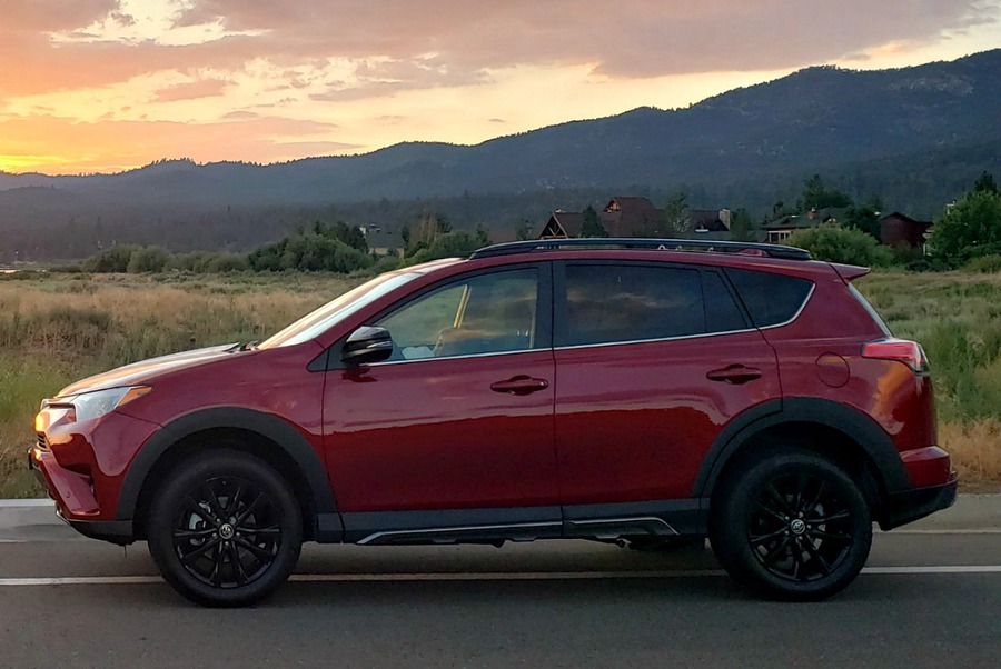 Side view of the Toyota RAV4 AWD Adventure at sunset - red and sporty