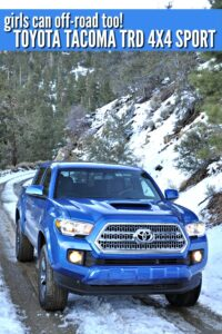 Blue Toyota Tacoma TRD 4x4 Offroading on snowy mountain roads